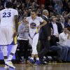 Golden State Warriors\' Stephen Curry (30) pulls up his shorts as he walks past Brooklyn Nets coach Jason Kidd after scoring during the second half of an NBA basketball game Saturday, Feb. 22, 2014, in Oakland, Calif. (AP Photo/Ben Margot)