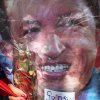 A supporter of Venezuela\'s President Hugo Chavez attends a celebration marking the leader\'s return, in Bolivar Square, in Caracas, Venezuela, Monday, Feb. 18, 2013. The woman holds a cutout image of Chavez along with a Saint Judas statue and a note that reads in Spanish: