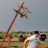 Branches of a tree are snagged in the wires of this bent utility pole on SH 74 near Cashion. by a tornado that came through the area Photo by Jim Beckel, The Oklahoman ORG XMIT: KOD