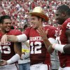 OU\'s Landry Jones (12) wears the Golden Hat Trophy with teammates OU\'s Trey Millard (33) and David King (90) during the Red River Rivalry college football game between the University of Oklahoma (OU) and the University of Texas (UT) at the Cotton Bowl in Dallas, Saturday, Oct. 13, 2012. Photo by Chris Landsberger, The Oklahoman