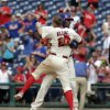 Photo - Philadelphia Phillies' Ryan Howard, back, celebrates with Cody Asche, front, after he hit a one run single against the New York Mets in the ninth inning of a baseball game Sunday, Aug. 10, 2014, in Philadelphia. The Phillies won 7-6.  (AP Photo/H. Rumph Jr)