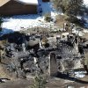 Photo - In this aerial photo, law enforcement authorities investigate the charred remains of a cabin Wednesday, Feb. 13, 2013, where quadruple-murder suspect Christopher Dorner is believed to have died after barricading himself inside during a Tuesday stand-off with police in the Angeles Oaks area of Big Bear, Calif. San Bernardino Sheriff's Deputy Jeremiah MacKay was killed and another wounded during the shootout with Dorner. (AP Photo/The Sun, John Valenzuela)