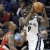 Photo - Memphis Grizzlies' Tony Allen (9) is pressured by Portland Trail Blazers' Damian Lillard, left, during first half of an NBA basketball game in Memphis, Tenn., Wednesday, March 6, 2013. (AP Photo/Danny Johnston)