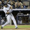 Detroit Tigers\' Delmon Young hits a solo home run in the eighth inning during Game 1 of the American League championship series against the New York Yankees Saturday, Oct. 13, 2012, in New York. (AP Photo/Paul Sancya )