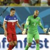 United States\' goalkeeper Tim Howard, right, talks with Matt Besler as they leave the pitch at half time during the group G World Cup soccer match between Ghana and the United States at the Arena das Dunas in Natal, Brazil, Monday, June 16, 2014. (AP Photo/Ricardo Mazalan)