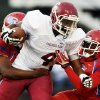 Crooked Oak\'s Shauntrel Skanes (4) is brought down after a carry by John Marshall\'s Juan Hill (53), left, and Joseph Shells (10) during a high school football game between John Marshall and Crooked Oak at Star Spencer\'s Carl Twidwell Stadium, 3001 NE Spencer Rd., in Spencer, Okla., Thursday, Sept. 19, 2013. Photo by Nate Billings, The Oklahoman