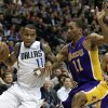 Dallas Mavericks\' Monta Ellis (11) attempts to get to the basket as Los Angeles Lakers\' Wesley Johnson (11) defends in the second half of an NBA basketball game, Tuesday, Jan. 7, 2014, in Dallas. The Mavericks won 110-97. (AP Photo/Tony Gutierrez)