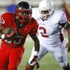 Del City\'s Anthony Mason runs past Ardmore\'s Darius Lawson during a high school football game in Del City, Okla., Friday, September 28, 2012. Photo by Bryan Terry, The Oklahoman