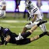 TCU quarterback Matt Brown (10) hits the turf in front of Kansas State defensive back Nigel Malone (24) during the first half of an NCAA college football game, Saturday, Nov. 10, 2012, in Fort Worth, Texas. (AP Photo/LM Otero)