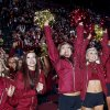 Photo - Florida State Golden Girls cheerleaders react as they watch Florida State score a touchdown on a 30-foot screen at the Tallahassee Leon County Civic Center in the second quarter of the NCAA BCS National Championship college football game against Auburn, Monday, Jan. 6, 2014, in Tallahassee, Fla. (AP Photo/Phil Sears)