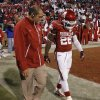OU\'s Damien Williams (26) walks off the field with a trainer after being hurt during the college football game between the University of Oklahoma Sooners (OU) and the Notre Dame Fighting Irish at the Gaylord Family-Oklahoma Memorial Stadium on Saturday, Oct. 27, 2012, in Norman, Okla. Photo by Chris Landsberger, The Oklahoman