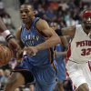 Photo - Oklahoma City Thunder's Russell Westbrook, left, dribbles past Detroit Pistons' Richard Hamilton (32) during the first half of their NBA basketball game on Friday, Dec. 26, 2008, in Auburn Hills, Mich. (AP Photo/Jerry S. Mendoza) ORG XMIT: MIJM102