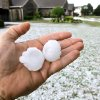 A homeowner holds two hailstones that pounded a neighborhood in Midwest City. A severe hail storm hit areas of eastern Oklahoma County, including these homes in the Windsong neighborhood, near SE 15 and Westminster, late Sunday afternoon, May 16, 2010. Photo by Jim Beckel, The Oklahoman