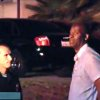 Photo - In this image taken from video from OnScene.tv, actor Michael Jace, right, is detained by police outside his home in Los Angeles on Monday night, May 19, 2014. Jace, who played a police officer on the hit TV show