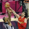 United States\' Tyson Chandler puts up a shot against Spain\'s Pau Gasol during the men\'s gold medal basketball game at the 2012 Summer Olympics, Sunday, Aug. 12, 2012, in London. (AP Photo/Matt Slocum)