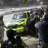 Matt Crafton makes a pit stop during the NASCAR Truck Series auto race Wednesday, July 24, 2013, on the dirt at Eldora Speedway in Rossburg, Ohio. (AP Photo/Dayton Daily News, Greg Lynch) LOCAL PRINT OUT AND LOCAL TV OUT (WKEF, WRGT, WDTN)