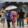 Base officials estimate more than 100,000 visitors will attend Tinker Air Force Base\'s annual Star Spangled Salute Air Show and Open House this Saturday and Sunday, June 21 and 22, 2014. The Air Force Thunderbirds, a military precision flying team, thrilled spectators with their close formations and daredevil-type flying Saturday afternoon. Organizers say the public will have an opportunity to view the largest collection of static displays in the history of the event. Hundreds stood in long lines in hot and humid conditions to walk through the E-3 Sentry on Saturday. Visitors also were able to get close looks at other military aircraft, including the B-1B Lancer, B-52 Stratofortress, C-17 Globemaster, CV-22 Osprey, E-6B Mercury, KC-135 Stratotanker. The event continues on Sunday, with aerial acts starting at noon. Photo by Jim Beckel, The Oklahoman