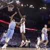Oklahoma City\'s Serge Ibaka (9) lays up a shot over Denver\'s Kenyon Martin (4) during the first round NBA playoff game between the Oklahoma City Thunder and the Denver Nuggets on Sunday, April 17, 2011, in Oklahoma City, Okla. Photo by Chris Landsberger, The Oklahoman