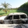 A burnt car in front of U.S. consulate, after an attack that killed four Americans, including Ambassador Chris Stevens on the night of Tuesday, in Benghazi, Libya, Thursday, Sept. 13, 2012. The American ambassador to Libya and three other Americans were killed when a mob of protesters and gunmen overwhelmed the U.S. Consulate in Benghazi, setting fire to it in outrage over a film that ridicules Islam\'s Prophet Muhammad. Ambassador Chris Stevens, 52, died as he and a group of embassy employees went to the consulate to try to evacuate staff as a crowd of hundreds attacked the consulate Tuesday evening, many of them firing machine-guns and rocket-propelled grenades. (AP Photo/Mohammad Hannon) ORG XMIT: MH102