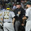 Photo - Oakland Athletics catcher Derek Norris (36), pitcher Jon Lester (31) and manager Bob Melvin plead their case to umpire Ted Barrett after an infield line drive and error allowed Atlanta Braves' Justin Upton to advance from first base to third base during the second inning of a baseball game Sunday, Aug. 17, 2014, in Atlanta. (AP Photo/David Tulis)