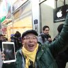 FILE -In this Friday, Nov. 2, 2012, file photo, a customer, Song Tae-min reacts after buying a new iPad Mini in Seoul, South Korea. The new iPad Mini is sure to please millions this holiday season. But fans of the latest full-size iPad have reason to look down on this newcomer: compared to other Apple products, the screen just isn't that good. (AP Photo/Ahn Young-joon)
