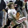 Owasso\'s Nick DiMarco loses his helmet as he is hit by Westmoore\'s Addison Staggs during their playoff game at Moore High School in Moore, Oklahoma, on Friday Nov. 19, 2010. Photo by John Clanton, The Oklahoman