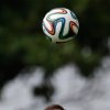 Photo - England national soccer team player Wayne Rooney heads a ball during a squad training session for the 2014 soccer World Cup at the Urca military base in Rio de Janeiro, Brazil, Wednesday, June 11, 2014.  The England soccer team are staying in Rio de Janeiro as their base city for the 2014 soccer World Cup.  (AP Photo/Matt Dunham)