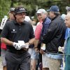 Phil Mickelson smiles as he walks to the 13th tee box during the first round of the U.S. Open golf tournament at Merion Golf Club, Thursday, June 13, 2013, in Ardmore, Pa. (AP Photo/Charlie Riedel)