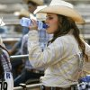 Contestant Shiane Lockard, from Tecumseh, takes a drink of water during the International Finals Youth Rodeo in Shawnee, OK, Tuesday, July 12, 2011. By Paul Hellstern, The Oklahoman