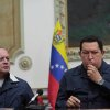 Photo - In this photo released by Miraflores Press Office, Venezuela's President Hugo Chavez , right, kisses a crucifix beside the President of the national Assembly Diosdado Cabello during a televised speech form his office at Miraflores Presidential palace in Caracas, Venezuela, Saturday, Dec. 8, 2012. Chavez announced Saturday night that his cancer has returned and that he will undergo another surgery in Cuba. Chavez, who won re-election on Oct. 7, also said for the first time that if his health were to worsen, his successor would be Vice President Nicolas Maduro.(AP Photo/Miraflores Press Office, Marcelo Garcia)