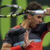 Photo - Spain's Rafael Nadal returns the ball to Ernests Gulbis of Latvia during the quarter final at ExxonMobil Qatar ATP Open Tennis tournament at the Khalifa Tennis Complex in Doha, Qatar, Thursday, Jan. 2, 2014. (AP Photo/Osama Faisal)