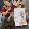 Sooner fans William Winfree and Andrew Hajek, from left, sit on the curb as they wait to get in the gates before the BCS National Championship college football game between the University of Oklahoma Sooners (OU) and the University of Florida Gators (UF) on Thursday, Jan. 8, 2009, at Dolphin Stadium in Miami Gardens, Fla. PHOTO BY CHRIS LANDSBERGER, THE OKLAHOMAN