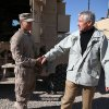 Photo - U.S. Secretary of Defense Chuck Hagel, right, shakes hands with U.S. Marine Lance CPL. Arron Corona as he works on a MRAP vehicle, at Camp Bastion, Afghanistan, Sunday, Dec. 8, 2013. Hagel spoke with troops and thanked them for being deployed for the holidays. (AP Photo/Mark Wilson, Pool)