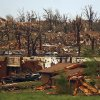 Rescuers and neighbors look through the the wreckage of destroyed homes on a hillside in Joplin, Mo., Sunday, May 22, 2011. A large tornado moved through much of the city, damaging a hospital and hundreds of homes and businesses. (AP Photo/Mark Schiefelbein) ORG XMIT: MOMS105