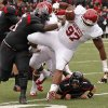 Oklahoma\'s Jamarkus McFarland (97) fumbles the ball after an interception beside Texas Tech\'s LaAdrian Waddle (65) at Jones AT&T Stadium in Lubbock, Texas, Saturday, Oct. 6, 2012. Photo by Bryan Terry, The Oklahoman