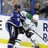 Photo - Tampa Bay Lightning center Steven Stamkos (91) pushes Dallas Stars defenseman Trevor Daley (6) into the boards during the first period of an NHL hockey game on Saturday, April 5, 2014, in Tampa, Fla. (AP Photo/Chris O'Meara)