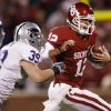 Photo - Landry Jones tries to get past Kansas State's John Houlik during the second half of Oklahoma's 42-30 victory over Kansas State. Photo by Chris Landsberger, The Oklahoman
