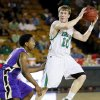 Bishop McGuinness\' Greg Roberts (10) looks to pass away from Chickasha\'s Deshawn Young (21) during a Class 5A boys high school basketball game in the semifinals of the state tournament at the Mabee Center in Tulsa, Okla., Friday, March 8, 2013. Photo by Nate Billings, The Oklahoman