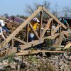 People sort the remains of a home near Plaza Tower Elementary in Moore, Okla., on Wednesday, May 22, 2013. The area was heavily damaged by a tornado that struck on Monday, May 20, 2013. Photo by Bryan Terry, The Oklahoman