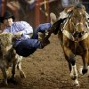 Walt Sherry of Atwook, Okla., competes in steer wrestling during the International Finals Rodeo (IFR 44) at the Jim Norick Arena at State Fair Park in Oklahoma City, Sunday, Jan. 19, 2014. Photo by Nate Billings, The Oklahoman