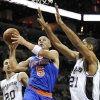 New York Knicks\' Jason Kidd (5) shoots over San Antonio Spurs\' Tim Duncan, right, during the first half of an NBA basketball game on Thursday, Nov. 15, 2012, in San Antonio. (AP Photo/Darren Abate)