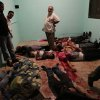 EDITOR\'S NOTE: GRAPHIC CONTENT - Bodies lie in a room of a hospital after shooting happened at the Republican Guard building in Nasser City, Cairo, Monday, July 8, 2013. Egyptian soldiers and police opened fire on supporters of the ousted president early Monday in violence outside the military building in Cairo where demonstrators had been holding a sit-in, government officials and witnesses said. (AP Photo/Wissam Nassar)