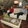 Photo - In this Sunday, Jan. 12, 2014, photo, Rebecca Gwynne, left, of Tuckahoe, N.Y., answers a question as Marijane Hamren inspects Gwynne's Simplicity Sofa with her husband Jim Hamren, in Tuckahoe, N.Y.  While Simplicity's furniture is sold only over the Internet, some customers want to see and try out the sofas and chairs. Owner Jeff Frank contacts people who have already bought his furniture, and asks them if they'll let a prospective customer stop by to take a look. (AP Photo/Kathy Willens)