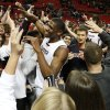 Photo - Texas Tech's Jordan Tolbert, center, is greeted by fans after a win over Baylor in an NCAA college basketball game in Lubbock, Texas, Wednesday, Jan, 15, 2014. (AP Photo/Lubbock Avalanche-Journal, Tori Eichberger) ALL LOCAL TV OUT