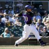 Photo - Colorado Rockies' Nolan Arenado watches his two-run home home against the Kansas City Royals during the sixth inning of a spring exhibition baseball game in Scottsdale, Ariz., Monday, March 24, 2014. (AP Photo/Chris Carlson)