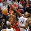 Photo - Atlanta Hawks' Joe Johnson, second from right, goes to the basket against Oklahoma City Thunder's Jeff Green (22) in the fourth quarter of an NBA basketball game in Atlanta, Monday, Jan. 18, 2010.  The Thunder won 94-91.  (AP Photo/Rich Addicks) ORG XMIT: GARA110