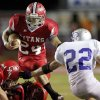 Carl Albert\'s Kenton Whittington leaps beside Guthrie\'s Luke Davis during a high school football game at Carl Albert in Midwest City, Okla., Friday, October 15, 2010. Photo by Bryan Terry, The Oklahoman