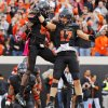 Oklahoma State\'s Charlie Moore (17) and Isaiah Anderson (82) celebrate a touchdown catch by Moore in the third quarter during a college football game between Oklahoma State University (OSU) and Texas Christian University (TCU) at Boone Pickens Stadium in Stillwater, Okla., Saturday, Oct. 27, 2012. OSU won, 36-14. Photo by Nate Billings, The Oklahoman