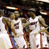 Miami Heat players Dwyane Wade (3) and Udonis Haslem (40) try to restrain Oklahoma City Thunder\'s Russell Westbrook (0) from Heat player Jermaine O\'Neal (7) during a first half of an NBA basketball game in Miami, Tuesday, Nov. 17, 2009. (AP Photo/J Pat Carter)