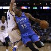 Oklahoma City Thunder\'s Kevin Durant (35) drives the ball around Golden State Warriors\' David Lee, left, during the first half of an NBA basketball game Thursday, Nov. 14, 2013, in Oakland, Calif. (AP Photo/Ben Margot)